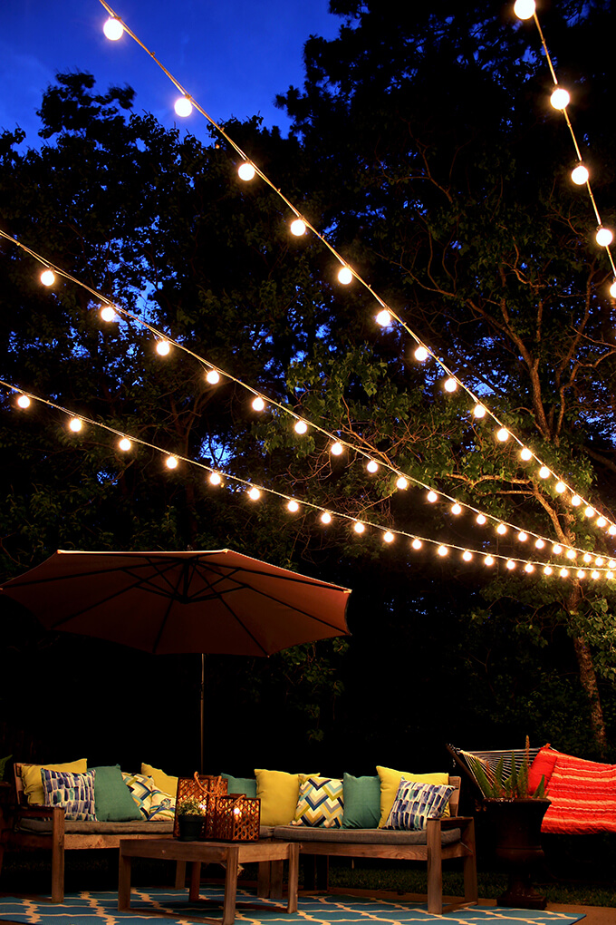 A Canopy Of String Lights In Our Backyard Gray House Studio