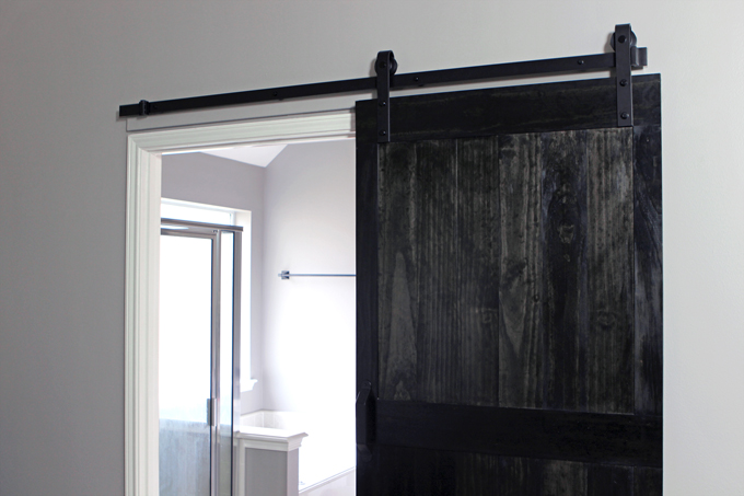 PLACE DOOR ON TRACK & HOW TO INSTALL A BARN DOOR | Gray House Studio